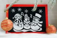 Imagen de la nieve artificial en la caja roja Fotos de archivo