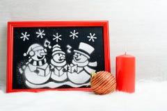 Imagen de la nieve artificial en la caja roja Imagen de archivo