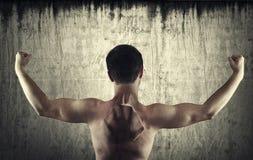 Imagen de la parte posterior de un hombre descamisado Fotografía de archivo