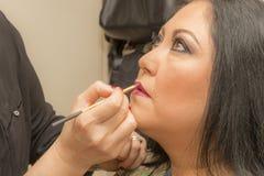 Imagen de los labios del maquillaje en un maquillaje profesional fotografía de archivo