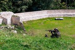 Imagen de soldados en la acción Fotos de archivo libres de regalías