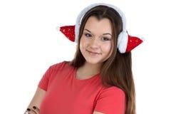 Imagen del adolescente con los auriculares de Navidad Fotos de archivo