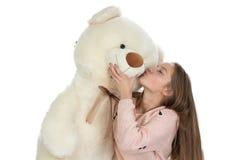 Imagen del adolescente feliz con el oso de peluche Imagen de archivo