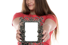 Imagen del adolescente que muestra el marco de la foto Fotos de archivo