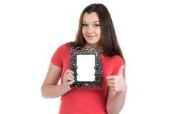 Imagen del adolescente sonriente con el marco de la foto Imágenes de archivo libres de regalías