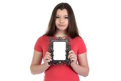 Imagen del adolescente triste con el marco de la foto Fotos de archivo libres de regalías