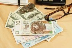 Imagen del dinero y de una calculadora Foto de archivo libre de regalías