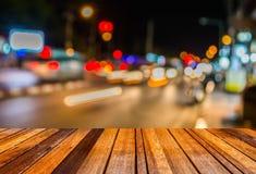 imagen del fondo del bokeh de la calle de la falta de definición con las luces coloridas calientes Foto de archivo