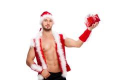 Imagen del hombre atractivo que lleva el traje de Papá Noel, aislada en blanco Imagen de archivo