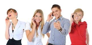 Imagen del hombre y de la mujer con los teléfonos celulares Imagen de archivo libre de regalías