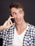Imagen del muchacho con el teléfono elegante Imágenes de archivo libres de regalías
