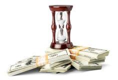 Imagen del tiempo y del concepto del dinero - enarene el reloj y imágenes de archivo libres de regalías