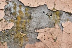 Imagen del yeso destructivo en la pared del edificio imagen de archivo
