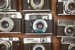 Imagen diseñada retra de las cámaras viejas de la foto en un mercado de la huida Imagen de archivo libre de regalías