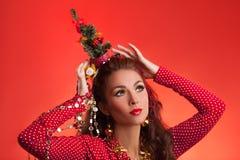 Imagen divertida de los días de fiesta del Año Nuevo y de la Navidad con el modelo Foto de archivo libre de regalías