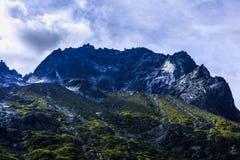 Imagen dramática con el pico de montaña Fotografía de archivo libre de regalías