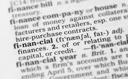 Imagen macra de la definición de diccionario de financiero foto de archivo