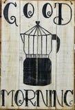 Imagen negra mañana del fabricante de café del géiser y de la inscripción negra de la mañana de la buena en los tablones viejos d stock de ilustración