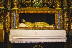 Imagen reclinada de Jesus Christ, de la adoración y de la religión Foto de archivo