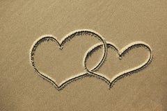 Imagens dos corações na areia imagem de stock