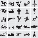 25  images of childrens toys. 20  black vector images of childrens toys on a grey background Stock Image