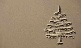 Images christmas tree in the sand Royalty Free Stock Photos
