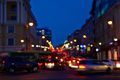 Images of the city at night is blurred. For a background texture abstract lights glow royalty free stock images