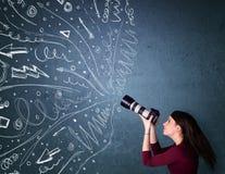 Images de tir de photographe tandis que lignes tirées par la main énergiques Photographie stock libre de droits