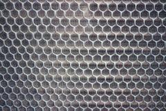 Images en gros plan d'acier, nid d'abeilles, trous, trous, rouille, images pour les milieux abstraits photographie stock libre de droits