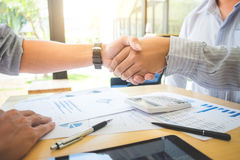 Images of executive businessman shaking hands after finishing up Stock Photo