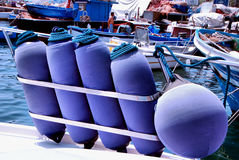Images of a Fender. Different fenders placed in their containers on the bow of a boat Stock Photos