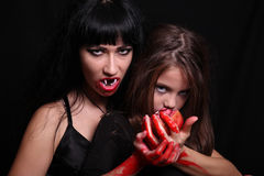 Images for Halloween. Mom and daughter in the image of vampires for Halloween Royalty Free Stock Image
