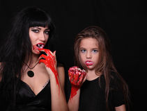 Images for Halloween. Mom and daughter in the image of vampires for Halloween Stock Images