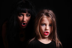 Images for Halloween. Mom and daughter in the image of vampires for Halloween Royalty Free Stock Photo