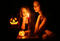 Images for Halloween. Mom and daughter are preparing for Halloween Stock Image