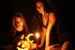 Images for Halloween. Mom and daughter are preparing for Halloween Royalty Free Stock Photography