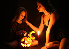 Images for Halloween. Mom and daughter are preparing for Halloween Stock Photo
