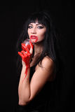 Images for Halloween. The woman in the image of a vampire for Halloween Stock Photos