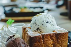 Images near desserts, ice cream, chocolate chips on bread, blurred images. At cafe stock photos