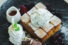 Images near desserts, ice cream, chocolate chips on bread, blurred images. At cafe royalty free stock photos