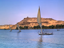 Images from Nile. Felukas sailing in Nile River. Egypt series Royalty Free Stock Images