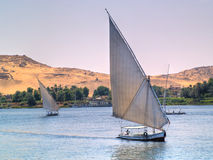 Images from Nile. Felukas sailing in Nile River. Egypt series Stock Photography