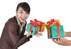 Images of women to guess the contents of a gift. Image of woman guessing what present he is going to receive from his colleagues, isolated on white background royalty free stock images