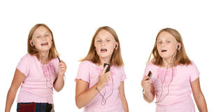 Images of young girl dancing with mp3 Stock Images