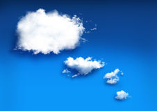 Imaginación de nubes en fondo azul Imagenes de archivo