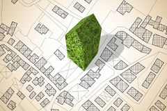 Imaginary city map with a green building - The architecture of the future - concept image.  royalty free stock photos