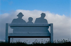 Imaginary Family. Bench originally formed on a meadow Royalty Free Stock Photo