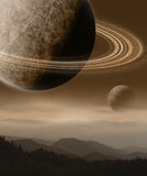 Imaginary Landscape with Planets. Otherworldly concept of rugged terrain and ringed planets Stock Photo