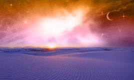 Fantasy Space Sunset. An imaginary landscape of sand dunes and planets from outer space Stock Photos