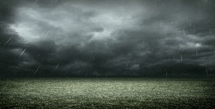 The Imaginary Soccer Stadium with dark clouds and rain, 3d rendering Stock Photos